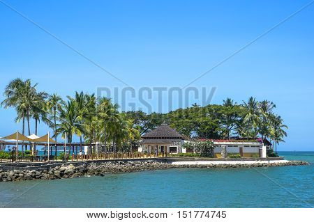 Kota Kinabalu,Sabah-Feb 4,2016:Beautiful tropical palm trees at Bar Shangri-La's Tanjung Aru Resort and Spa, Kota Kinabalu on 4th February 2016.