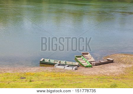 five wooden boats for fishing stay ashore