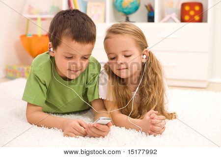 Little Boy And Girl Listening To Music
