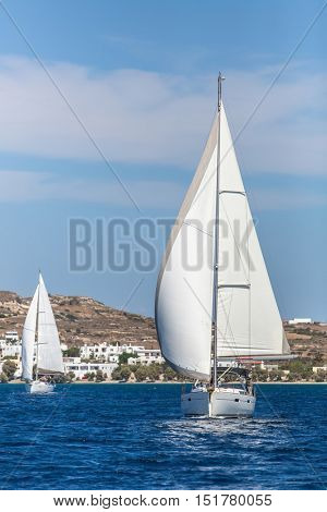 Sailing regatta among Greek islands in Aegean Sea.