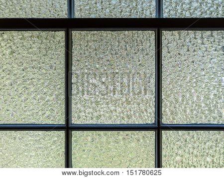 Horizontal, closeup image of textured window panes