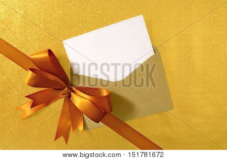 Christmas Or Birthday Card With Diagonal Gift Ribbon And Bow In Gold Satin On Shiny Paper Background