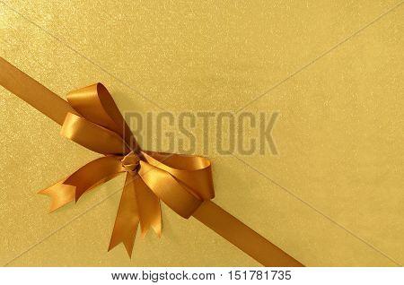 Gold Gift Bow And Ribbon, Shiny Metallic Foil Paper Background, Corner Diagonal