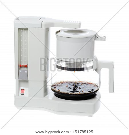 Making coffee in an electric grey plastic 1980s coffee maker isolated on white background.
