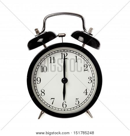 Back alarm clock with analog display six o clock isolated on white.