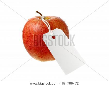 Red apple with white not yet written attached label isolated on white background.