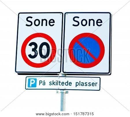 Norwegian road signs for a zone with speed limit 30 kph and parking prohibited exept for marked parking lots.