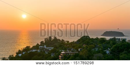 Colorful sunset over the sea and the island of Phuket, Thailand