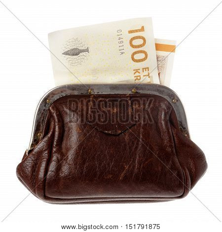 A brown purse with a Danish one hundred kroner bill isolated on white background.