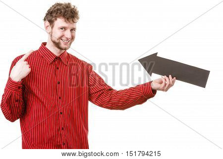 Advertising pointing indicating hint sign gesture communication concept. Adult man holding arrow. Young male showing arrowhead pointer.
