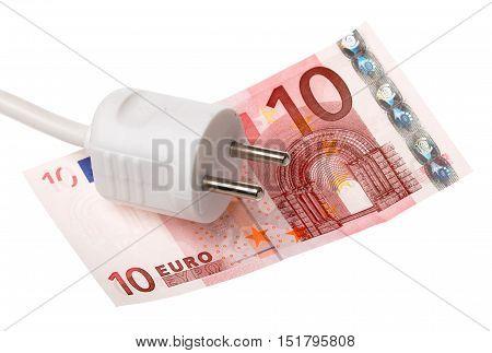 One white power plug on a ten Euros banknote isolated on white.