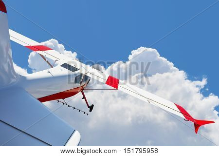 Aircraft spraying fields, light aircraft flying in the clouds, aviation, agriculture, cloudy sky