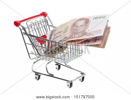 Shoppingcart filled with Tahi baht banknotes isolatedon white.