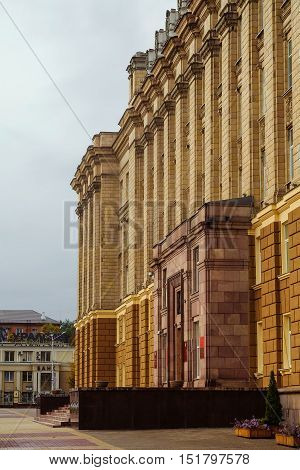 BELGOROD RUSSIA - OCTOBER 08 2016: Detail of the facade of the administrative building of the government of the Belgorod region Russian Federation. Main entrance. Former Soviet regional government