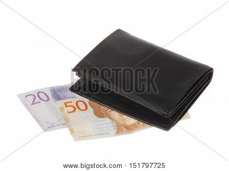 A black wallet placed on top of Swedish banknotes in denominations of twenty respektuve fifty crowns isolated on white background.