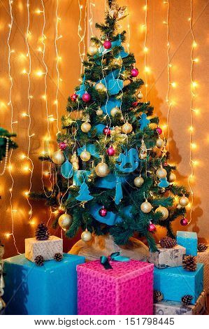 Christmas Room Interior Design, Xmas Tree Decorated By Lights Presents Gifts Toys, Candles And Garland Lighting Indoors