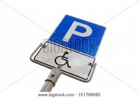Norwegign road signs at the parking space reserved for disabled persons.