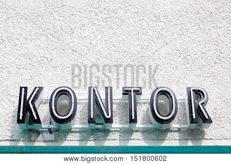 Generic Swedish sign for office on a bulding wall.