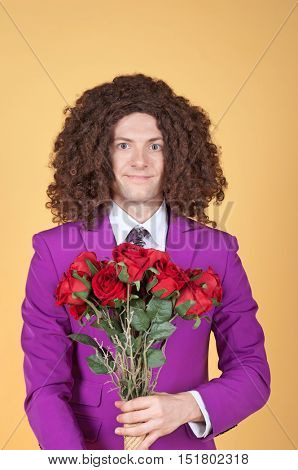 Caucasian man with afro wearing Purple Suit