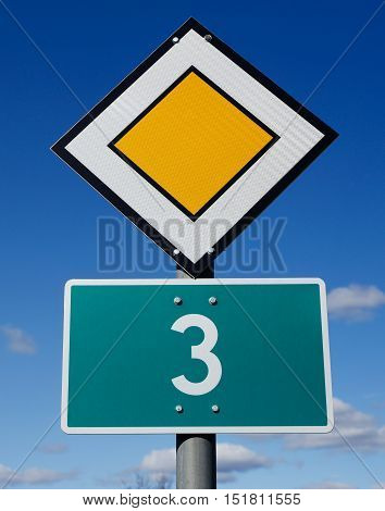 Primary road number 3.with road signs agains a blue sky.