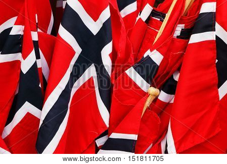 Close up group of small Norwegian flags.