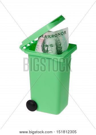 One green miniature recycle bin with a Swedish one hundred krona bannknote inside isolated on white.