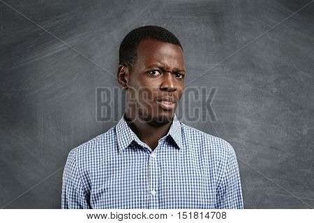 Are You Serious? Irritated Young Dark-skinned Teacher Or Student Dressed In Checkered Shirt, Looking