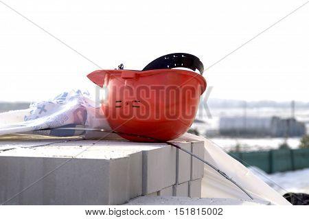 Construction protective helmet lies on the masonry