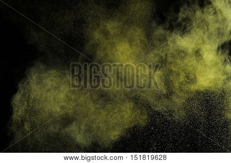 Gold Powder Explosion On Black Background.