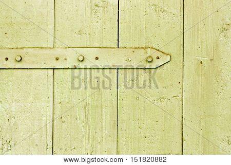 Rusty Metal Hinge On Wooden Hangar Door.