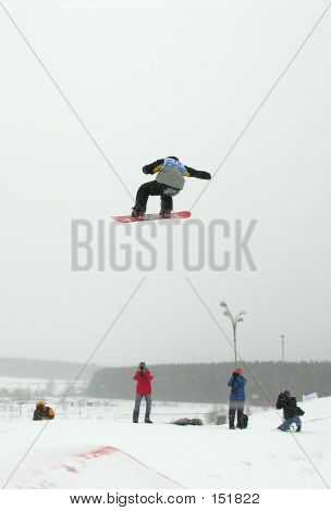 Snowboarder Jumping Above Photographers