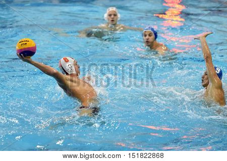 KAPOSVAR, HUNGARY - OCTOBER 5: David Dobos (white 8) in action at a Hungarian national championship water-polo game between Kaposvar (white) and Honved (blue) on October 5, 2016 in Kaposvar, Hungary