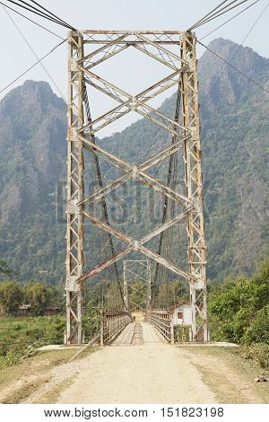 Old chain bridge crossing a river close to Vang Vieng, Laos, Asia