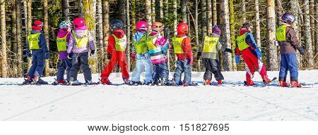 Panoramic view on french children from ski school groups