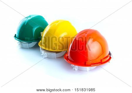 multicolor safety construction protection helmet isolated white background