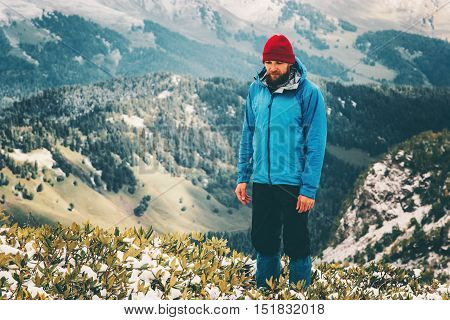 Traveler Man bearded hiking alone Travel Lifestyle aerial view mountains landscape adventure survival concept outdoor cliff aerial view