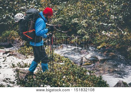 Traveler Man hiking alone in forest with big backpack Travel Lifestyle adventure survival concept outdoor wild nature