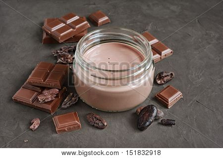 Chocolate Milk With Pieces Of Chocolate Bar And Cacao Beans