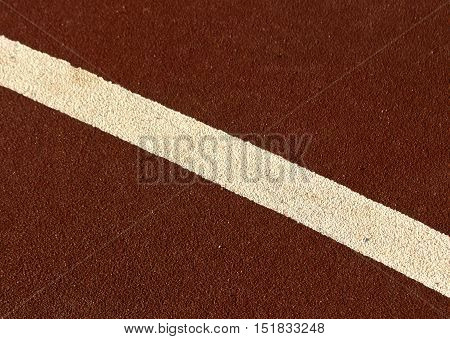 White Line On Running Track Surface.