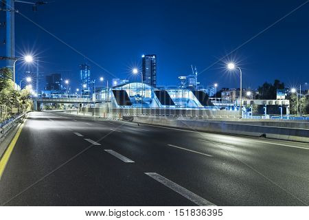 Empty freeway at night And Tel Aviv Cityscape with in Background