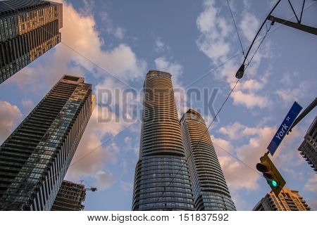 TORONTO,CANADA-AUGUST 2,2015:Toronto skyscrapers rise into the sky at sunset