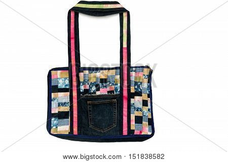 Beautiful women's bag on white background from colorful scraps of fabric in patchwork. Handmade.
