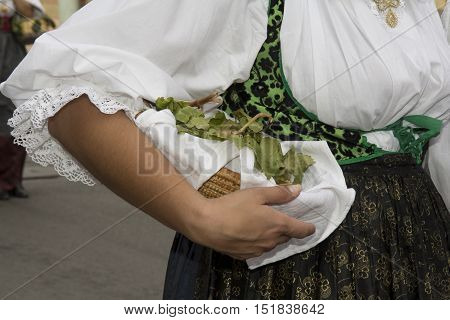 QUARTU S.E., ITALY - September 15, 2013: Wine Festival in honor of the celebration of St. Helena - Sardinia - detail of a female traditional Sardinian costumes