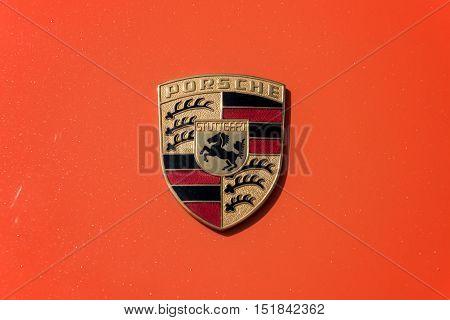 TURIN, ITALY - JUNE 9, 2016: Porsche logo on an orange car body