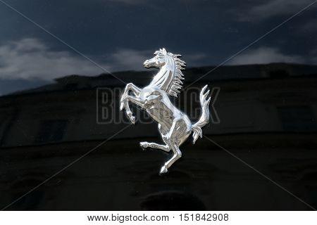 TURIN, ITALY - JUNE 9, 2016: Ferrari prancing horse on a black car body