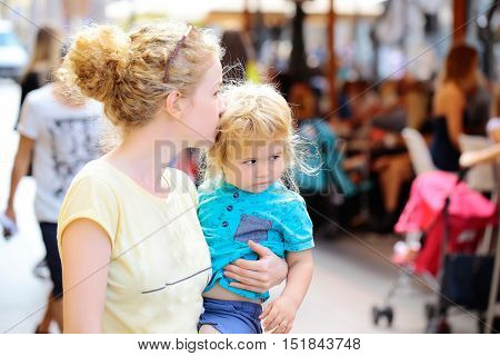 Mother Holds Son In Street
