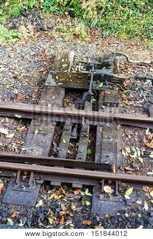 Narrow gauge rail track focus on points.