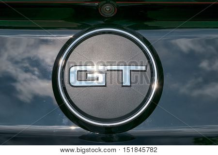 TURIN, ITALY - JUNE 9, 2016: Closeup of the GT logo on a Ford Mustang model