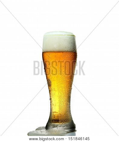 glass of frothy cold beer on a white background