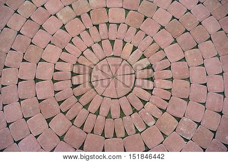 New red pavement of cobble stones in a circle pattern